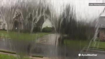 Heavy rain spills over gutters