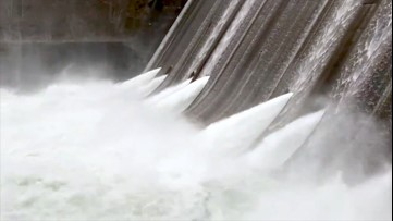 Water roars as it escapes dam
