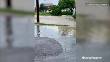 Flooding spills onto roads following storm