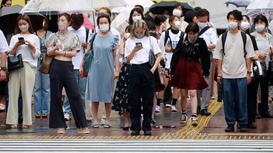 Japan expands coronavirus emergency, weighs legal penalties