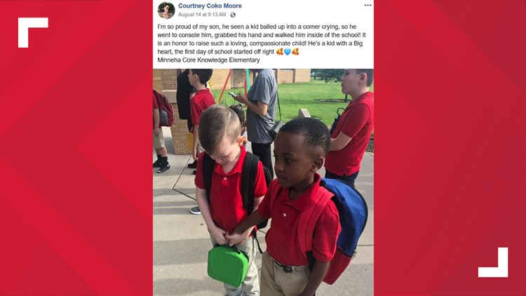 Boy holds classmate with autism's hand