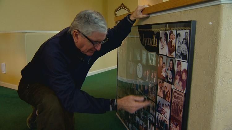 Former CU football coach Bill McCartney shows us photos of his family.
