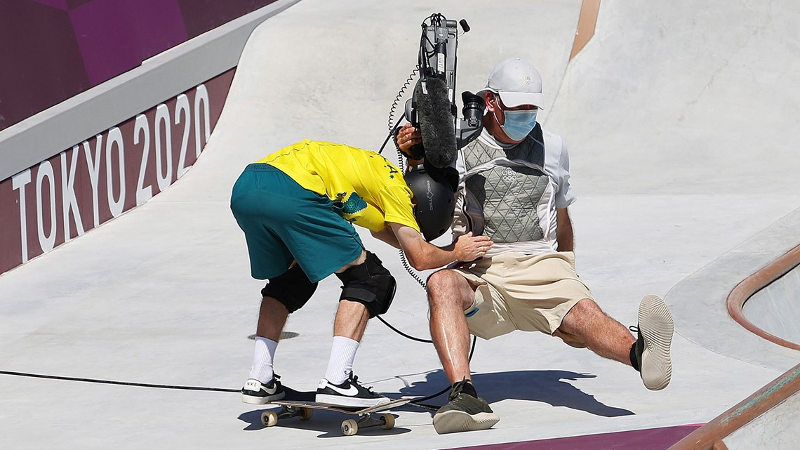 Olympic skateboarder takes out cameraman during run
