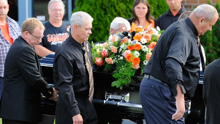 Pallbearers carry the casket of sprint car driver Kevin Ward Jr. prior to the funeral service at South Lewis Senior High School on August 14, 2014 in Turin, New York.