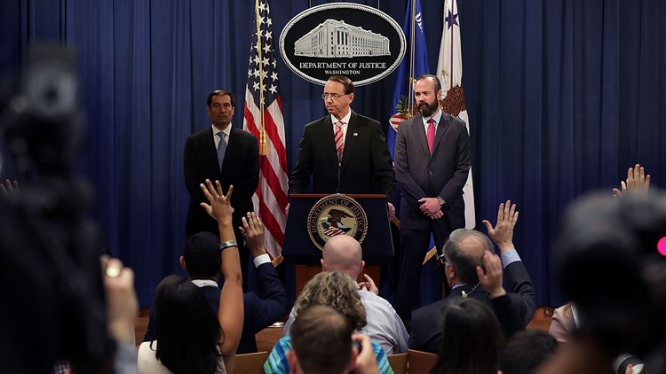 U.S. Deputy Attorney General Rod Rosenstein (C) holds a news conference at the Department of Justice July 13, 2018 in Washington, DC.
