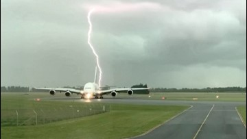 Video shows lightning appearing to hit Emirates plane twice