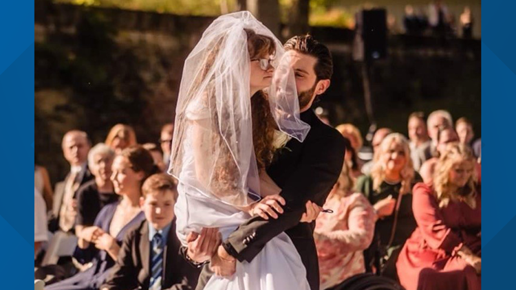 Ohio couple's wedding day goes viral after groom carries sister-in-law down the aisle
