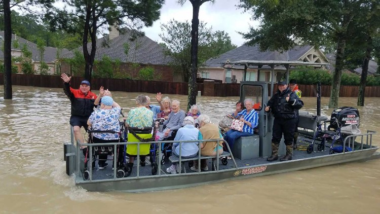 Norbert Ramon and some of the folks he helped rescue during historic flooding in Houston. Photo credit: Sgt. Epi Garza / Houston Police