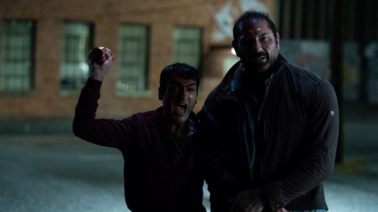 "Kumail Nanjiani as Stu and Dave Bautista as Vic in ""Stuber."""