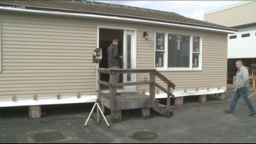 Student-built house auctioned off