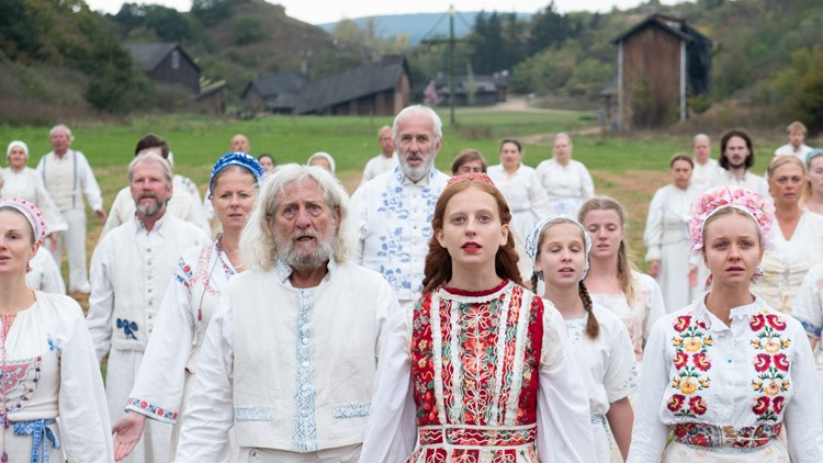Isabelle Grill (center) and Florence Pugh (right) in Midsommar, an A24 Picture