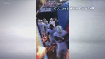 Dolphin accused of spitting on Bills fan