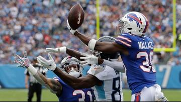 Allen throws 2 touchdown passes as Bills smother Titans