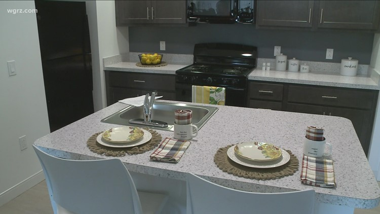 State, local officials show off new affordable housing at 201 Ellicott