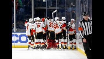 Flames top Sabres in OT