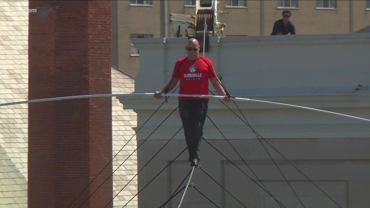 Nik Wallenda walks high wire above D'Youville campus to celebrate opening of their new HUB facility