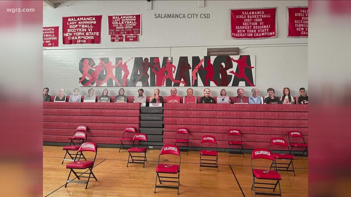 Salamanca City Schools puts up fan cutouts for sports games