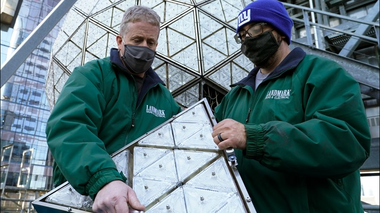 Workers install 192 crystals on Times Square New Year's ball