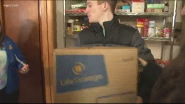 Following a food donation from FeedMore WNY's warehouse facility to a family in need