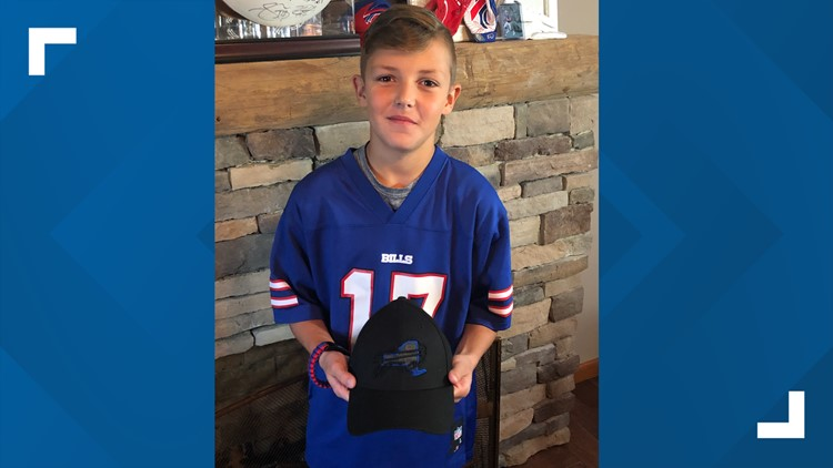 Josh Allen gave his hat to a boy who then turned to give the hat to his friend