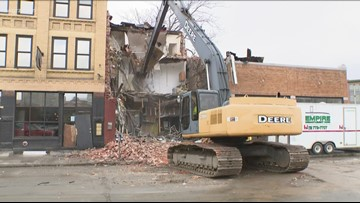 Owner of demolished Ellicott Street building to sell properties