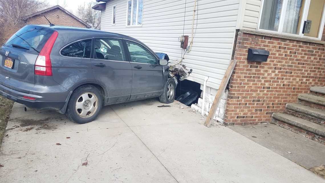 woman slams into side of house  after another car fails to