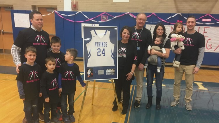 Late basketball coach's jersey retired