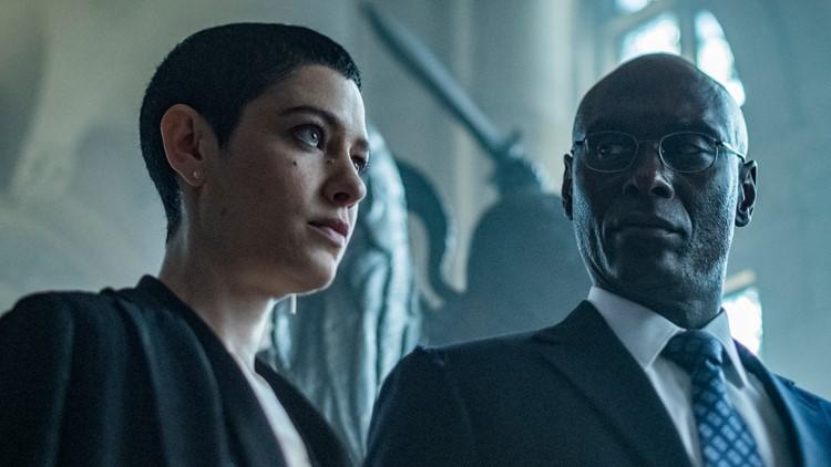 The Adjudicator (Asia Kate Dillon) and Charon (Lance Reddick) in JOHN WICK: CHAPTER 3 – PARABELLUM