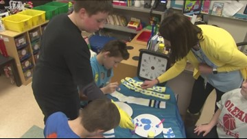 Olean students celebrate World Down Syndrome Day by tie-dying socks