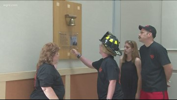 Junior volunteer firefighter rings Victory Bell at Roswell Park