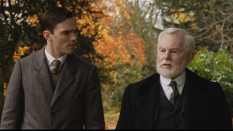 Nicholas Hoult and Derek Jacobi in the film TOLKIEN.