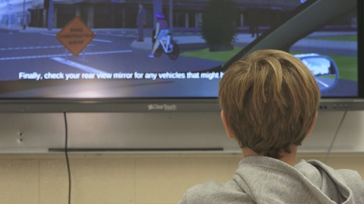 Teen using video game software to learn driving skills